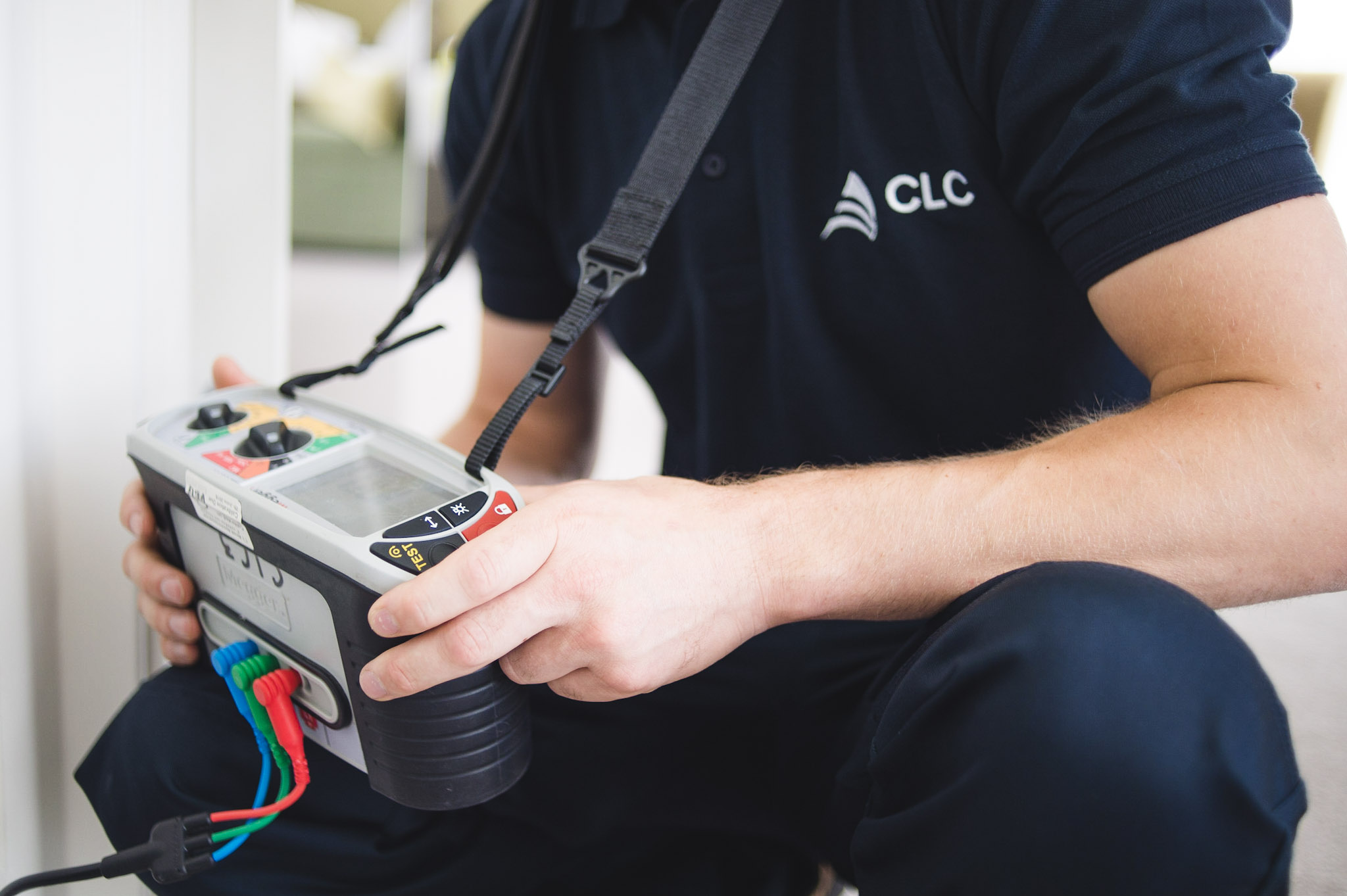 CLC worker holding electrical equipment