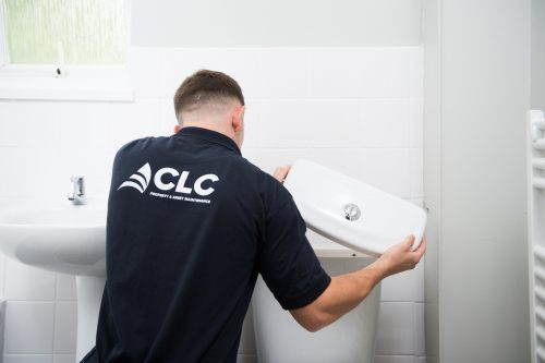 CLC worker fitting toilet