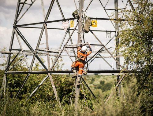 CLC worker climbing Pylon